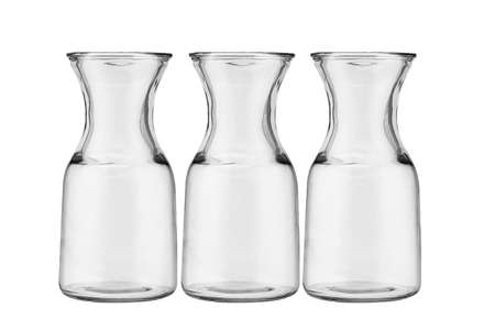 glass vase: Three glass jugs arranged on white background