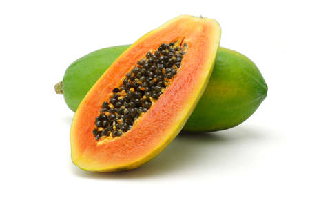 Half cut and whole papaya fruits on white background photo
