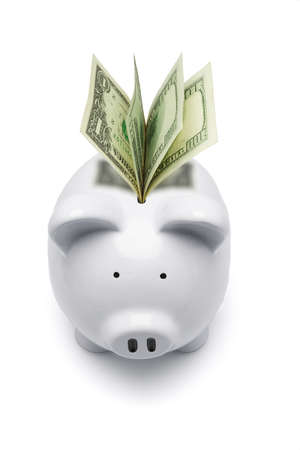 White piggy bank and US dollars on white background Stock Photo - 9766537