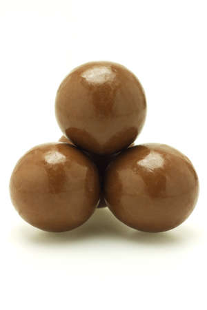 Chocolate balls arranged and stacked on white background Stock Photo - 9766492