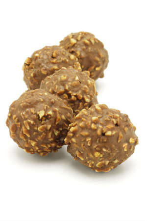 Five chocolate balls with nuts on white background Stock Photo - 9767612