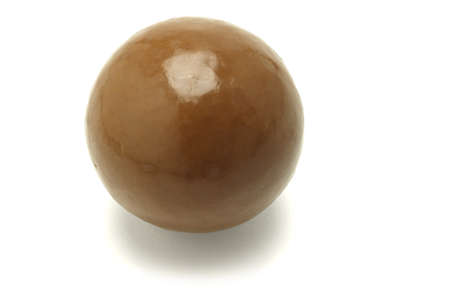 Close up of one large chocolate ball on white background photo