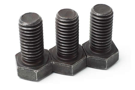 Three large used bolts in a row on white background photo