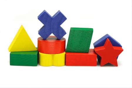 Wooden geometric toy blocks on white background photo
