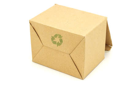 Recycle symbol printed on underside of empty carton box photo