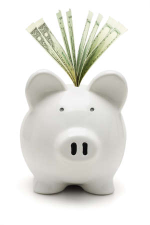 White piggy bank and US dollars on white background photo