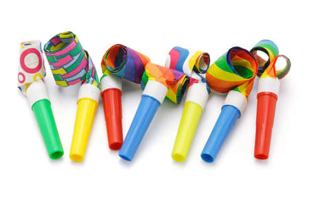 blowers: Colorful party blowers arranged in a row on white Stock Photo