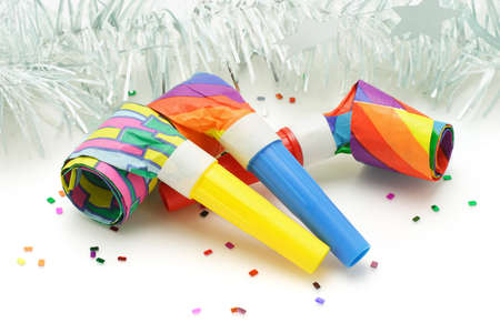 blowers: Three colorful paper party blowers or nosiemaker