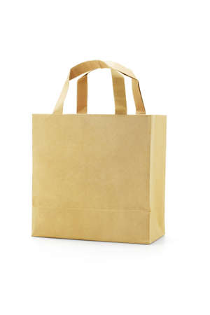 Brown reusable paper bag on white background photo