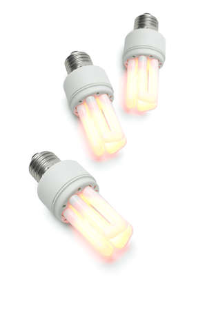 Glowing warm energy efficiency light bulbs on white background photo