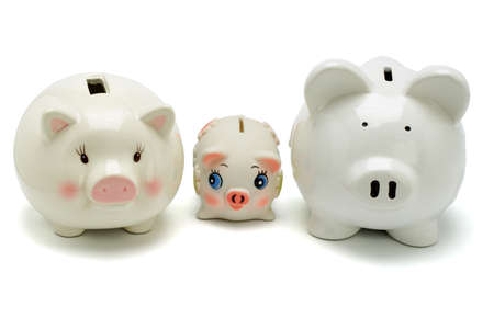 Family of piggy banks on white background photo