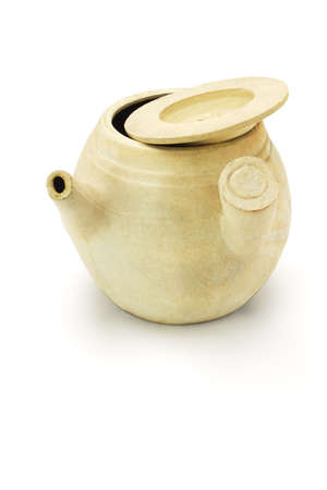 Chinese clay pot for boiling herbs on white background  photo