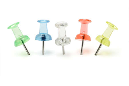 multicolor push pins arranged in a row on white background Stock Photo - 9767143