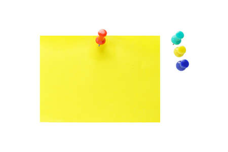 Multicolor push pins and yellow note paper on white background Stock Photo - 9767353