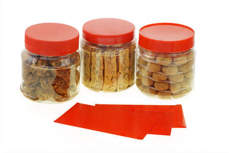 almond biscuit: Chinese New Year red packets and cookies in plastic containers