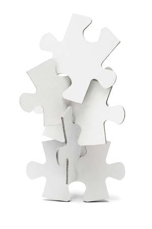 Pieces of jigsaw puzzles arranged to form a vertical tower photo