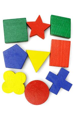 Assorted geometric blocks arranged on white background Stock Photo - 9768406