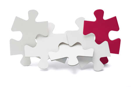 Jigsaw puzzle pieces interlocked and standing on white background Stock Photo - 9766474