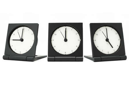 pm: Desktop alarm clocks showing 9 am to 5 pm on white background