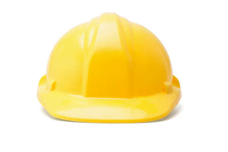Yellow hardhat safety helmet on white background photo