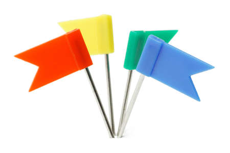 Multicolor plastic flag pins on white background photo