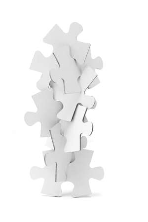 instability: Interlocking pieces of jigsaw puzzles tower on white background