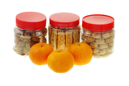 Chinese new year almond and peanut cookies with mandarin oranges on white photo