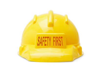Safety First yellow hardhat on white background photo
