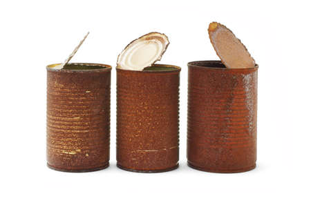 Rusty tin cans arranged on white background photo