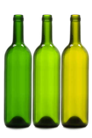 empty bottles: Tres botellas de vinos vac�as sobre fondo blanco Foto de archivo