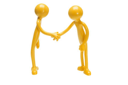 Toy rubber figurines shaking hands on white background photo