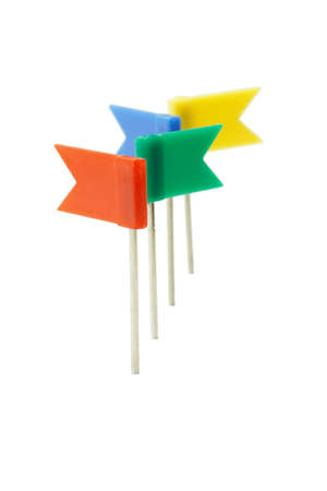 Multicolor plastic flag pins in a row on white background photo
