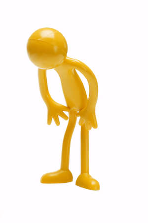 bowing: Toy rubber figurine bowing on white background
