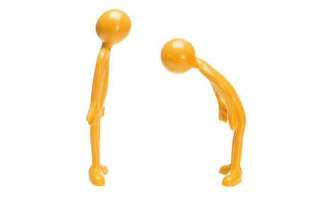 etiquette: Toy rubber figurine bowing to another on white background Stock Photo