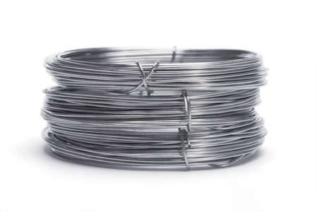 Stack of galvanized wires on white background