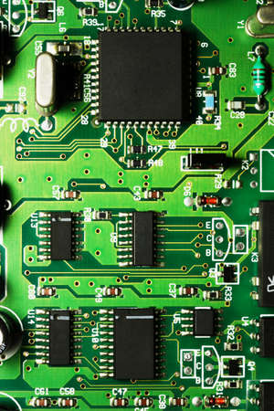 Electronic circuit board with chips and transitors photo