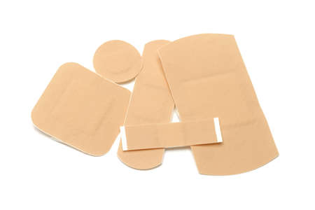 Assortment of first aid plasters on white background photo