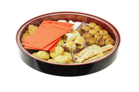 chinese new year food: Chinese new year cookies and red packets in gift tray