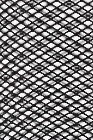 Abstract black wire mesh pattern with shadow on white background photo