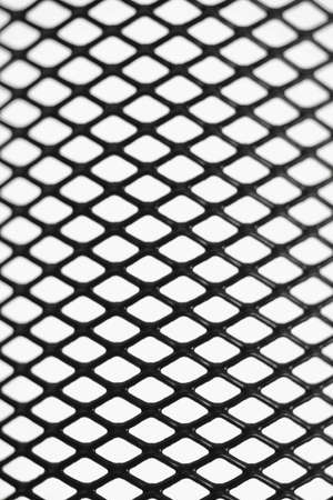 geometrical shapes: Black wire mesh pattern on white background Stock Photo