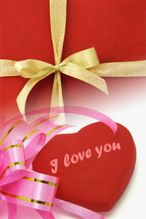 "Composite image of decorative ribbons and heart shape symbol with ""I love you"" for Valentine day"