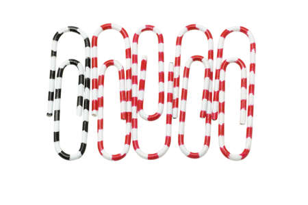Paper clips with black and red zebra stripes on white background Stock Photo - 9766519