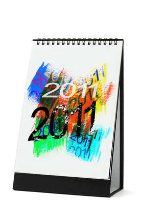Desktop calendar with abstract artwork 2011 on white background  (illustration on calendar page is an original work) 