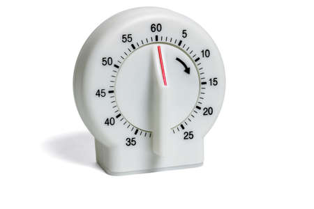 timekeeping: Plastic kitchen timer isolated on white background