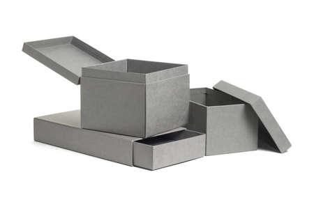 Open grey gift boxes on white background Stock Photo - 9853403