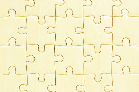 Close up of wooden jigsaw puzzles background photo