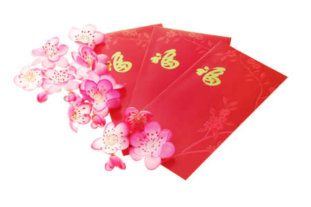 Chinese plum blossoms and red packets on white backgound photo