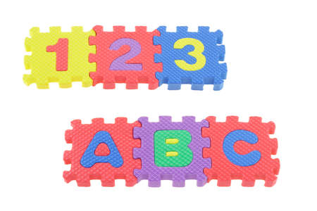 Colorful puzzle blocks with 123 and ABC arranged on white background photo