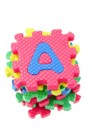 Top view of a stack of alphabet puzzle blocks on white background Stock Photo - 9853585