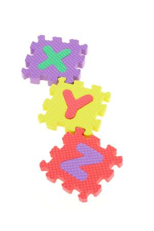 Colorful puzzle blocks with alphabets XYZ arranged on white background